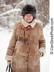 mature woman in wintry forest - Outdoor winter portrait of...