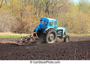 old tractor with plough - old agriculture tractor with...