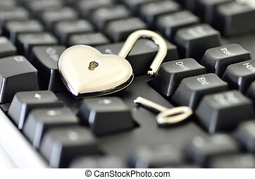 Computer security. Close-up of Heart-shaped padlock on...