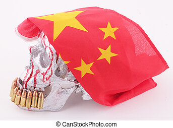 skull - A human skull with a chinese flag and 9mm cartridges...