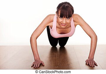 Woman Doing Press Ups - Smiling fit young woman facing the...