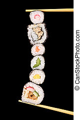 XXL sushi pieces, isolated on black background
