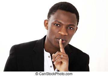 Finger on lips guy