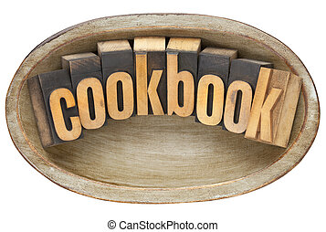 cookbook in wooden bowl