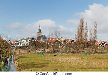 Typical Dutch village Marken with wooden green houses and...