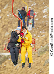 Young couple on the ropeway - Smiling youhg couple on the...