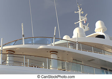 Yacht with multiple decks - Yacht deck irradiated with light...