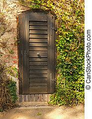 Traditional doors in the spring garden
