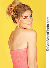 smiling woman in a pink tube top