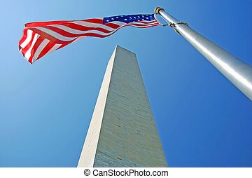 Washington Monument in Washington DC with flapping american...