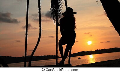 girl on the beach and evening sunse