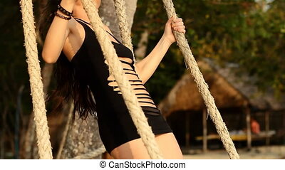 girl on the swing by the sea