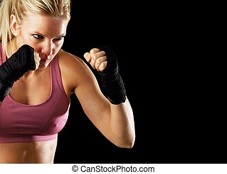 Ready to Fight - Portrait of a sexy fitness woman ready to...