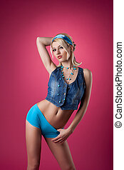 beauty blond woman stand on pink pin-up style