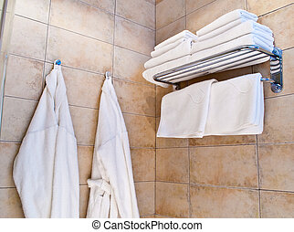towels and bathrobes - This is a closeup of a towels and...