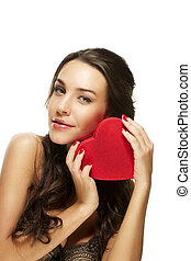 beautiful woman holding red heart on white background