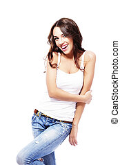 happy beautiful woman wearing blue jeans holding her arm on...