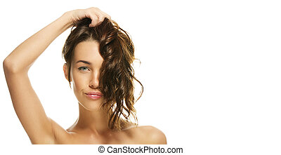 portrait of a beautiful woman holding her hair on white background