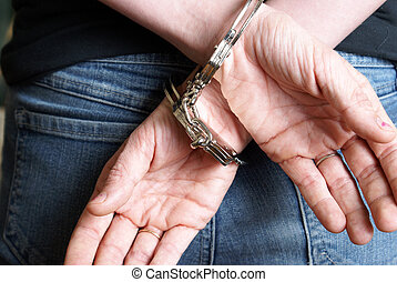 Arrested - A young woman has been arrested and handcuffed...