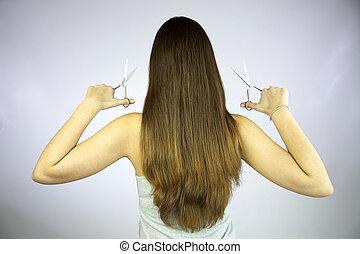 Girl with 2 pairs of scissor