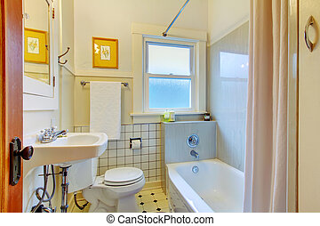 Retro simple bathroom with old sink and tiles.