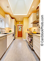 Yellow kitchen with white cabinets and stove - Yellow and...