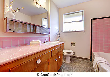 PInk old bathroom interior with tub.