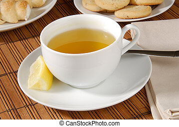 Afternoon tea - A cup of green tea with cookies and pastries