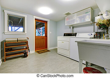 Large blue laundry room interior with sink. - Large grey...