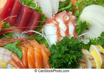 Seafood Sushi, sashimi and rolls on the dish