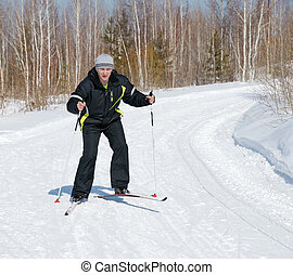 The man on the cross-country skiing - A man runs to ski...