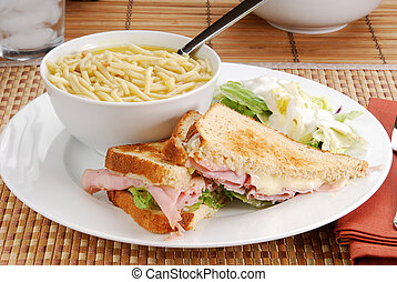 Soup, salad and a sandwich - Lunch of a ham and cheese...
