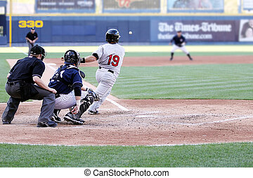 Right-handed baseball batter  getting a hit