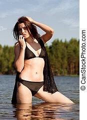 beautiful young woman at the lake.