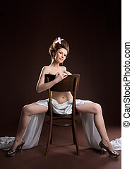 naked woman retro style art portrait - posing on chair