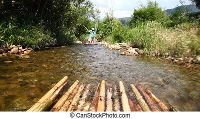 Rafting on the river. - People are floating on a raft of...