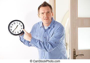 You are late - Angry man showing a clock. Common situation...
