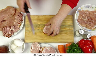 Food Preparation -Chopping Bacon - Women's hands slicing...