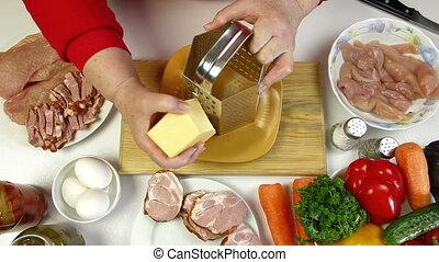 Food Preparation - Grating Cheese - Women's hands grating...