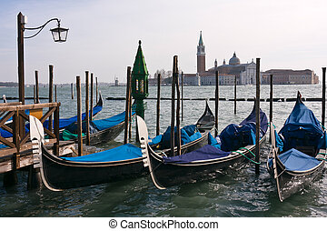 Gondolas moored by Saint Marks square in Venice - Gondolas...