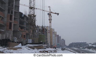 Winter construction. With the boom of a crane