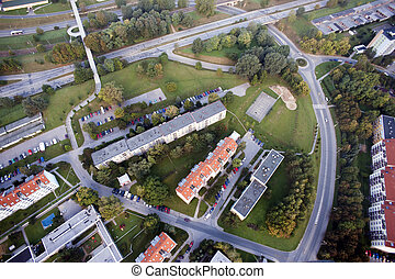 Aerial city view with crossroads, roads, houses, parks, parking lots, bridges, Brno, Czech Republic