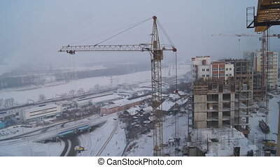Winter construction With the boom of a crane