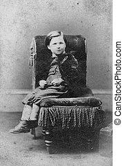 portrait of boy on chair - Portrait of boy on chair, black...