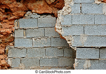 broken stone and cinder block walls - Broken stone and...