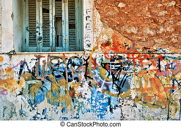 abandoned house wall with messy graffiti