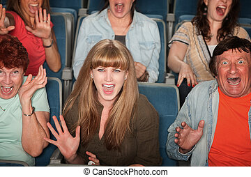 Scared People In Audience - Group of screaming people at the...