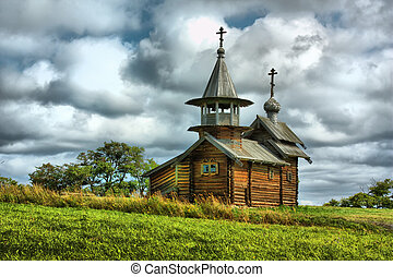 The wooden buildings of the ancient Russian architecture on...