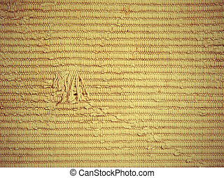 The rough knit fabric texture.
