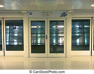 Airport sliding doors - Two closed sliding doors ins airport...